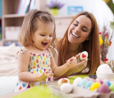 girl and mother smilng while playing